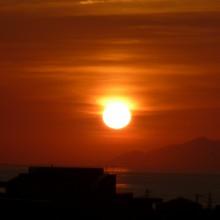 わが家の裏山から見える初秋の夕日